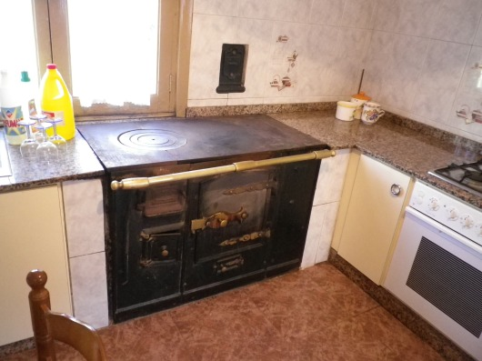 The kitchen had a wood burning stove which seemed to be in good working condition.